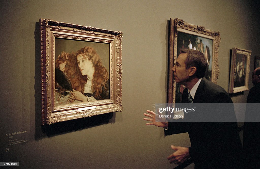 American artist Jeff Koons examines the Gustave Courbet painting 'Jo la belle Irlandaise' at the opening of the 19th century French painter's...
