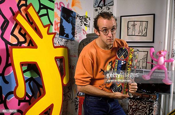 American artist Keith Haring holding a decorated radio cassette player in his studio New York City 1985