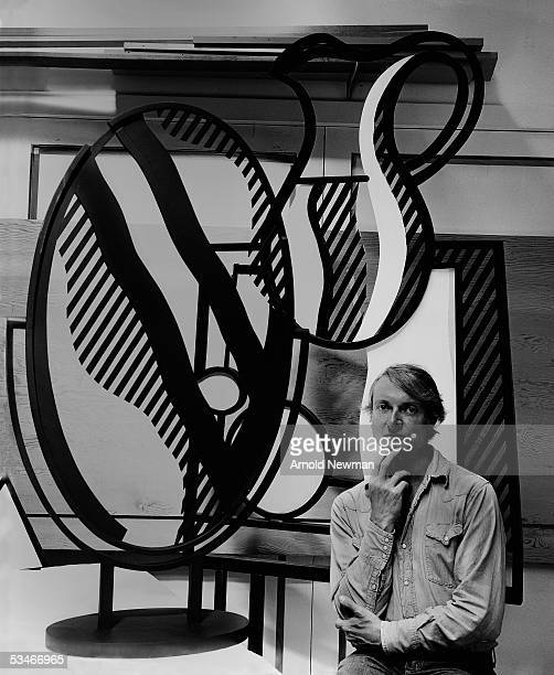 American artist Roy Lichtenstein poses next to one of his sculptures in his studio Southhampton Long Island New York September 18 1976
