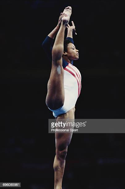 American artistic gymnast Dominique Dawes pictured in action competing for United States in the floor exercise during competition in the Women's...