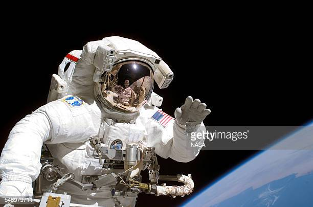American astronaut Joseph Tanner waves to the camera during a space walk as part of the STS115 mission to the International Space Station September...