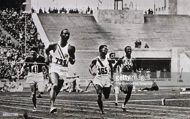 American athlete and Olympic gold medal winner Jesse Owens easily leads the pack in the semifinal heat of the Men's 100m event at the Olympic Games...
