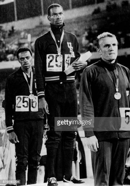 American athlete Bob Beamon stands on the podium with his black socks exposed as a sign of protestation against racism in the USA after his world and...