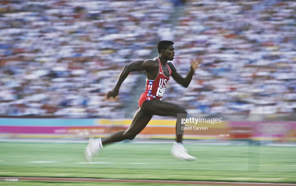 Carl Lewis of the USA accelerates down the runway of the long jump during the 1984 Summer Olympics at the Los Angeles Memorial Coliseum in Los Angeles, California. Mandatory Credit: David Cannon/Allsport