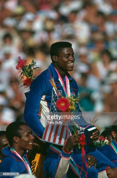 American athlete Carl Lewis is carried on the shoulders of his teammates after his team won the Men's 4 x 100 metres relay at the Los Angeles...