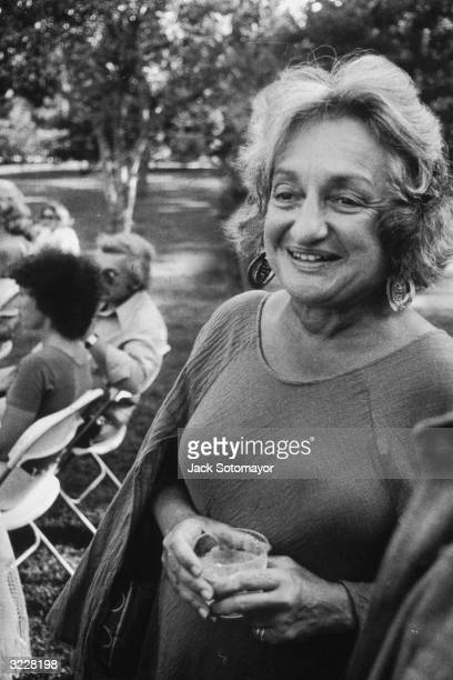 American author and feminist leader Betty Friedan holding a drink at a party for President Jimmy Carter Long Island New York