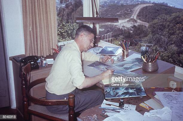American author and illustrator Dr Seuss working in his home office on a sketch of 'an alley cat for a very low alley' La Jolla California April 25...