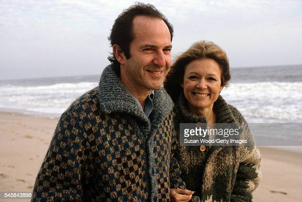 American author and political activist Gloria Steinem walks on the beach arm in arm with Canadianborn businessman Mortimer Zuckerman New York January...