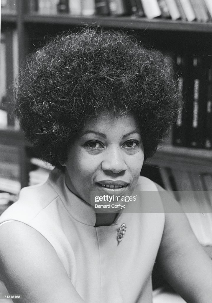 American author and winner of the Nobel Prize for Literature <a gi-track='captionPersonalityLinkClicked' href=/galleries/search?phrase=Toni+Morrison&family=editorial&specificpeople=213946 ng-click='$event.stopPropagation()'>Toni Morrison</a> sits and poses for a portrait in front of a bookshelf full of books, she is sporting a large hairdo, New York, 1970.