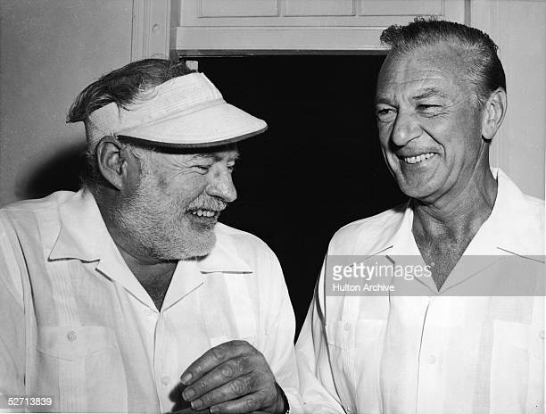American author Ernest Hemingway shares a laugh with actor Gary Cooper in Havana Cuba 1956 Cooper starred in the film adaptation of Hemingway's novel...