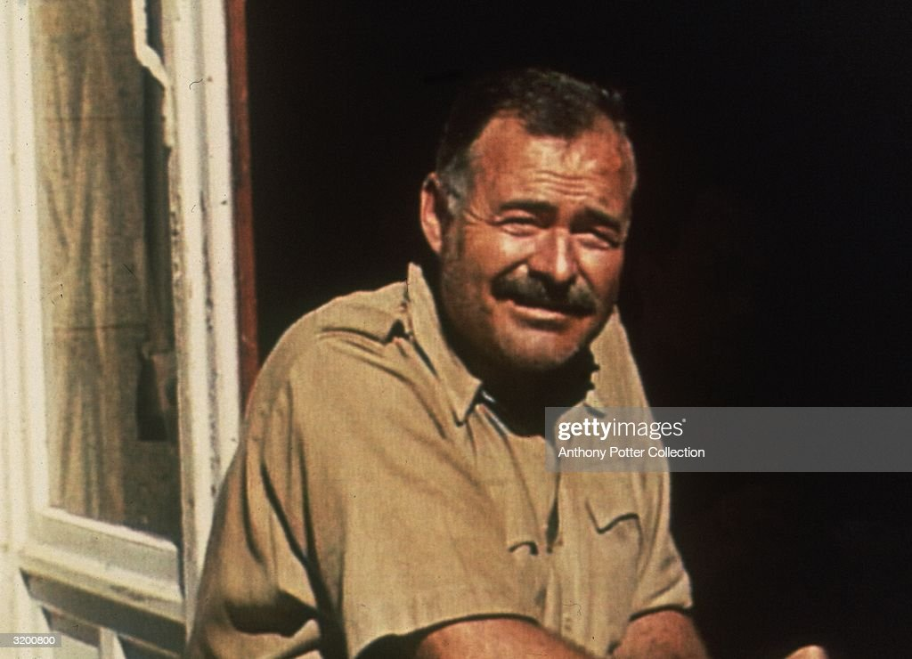 American author <a gi-track='captionPersonalityLinkClicked' href=/galleries/search?phrase=Ernest+Hemingway&family=editorial&specificpeople=93360 ng-click='$event.stopPropagation()'>Ernest Hemingway</a> (1899 - 1961) squinting as he sits near an open window in the sun, Mont St. Michel, France. Hemingway was in France covering World War II as a correspondent.