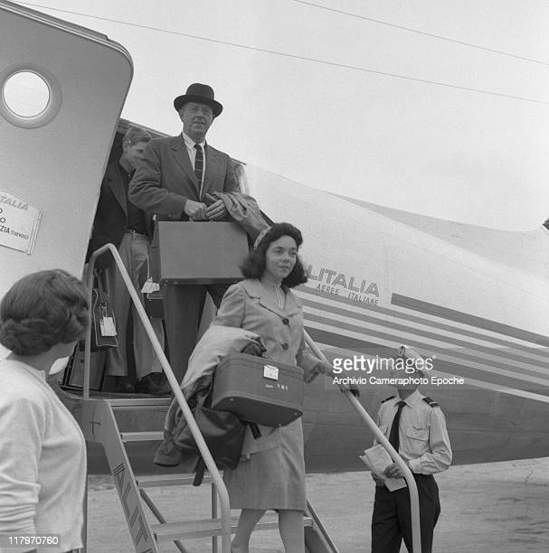 American author Erskine Caldwell and his third wife portrayed while getting down an Alitalia airplane at Marco Polo airport Tessera Venice for the...