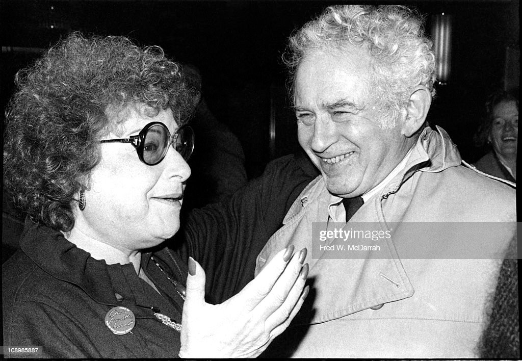 American author <a gi-track='captionPersonalityLinkClicked' href=/galleries/search?phrase=Norman+Mailer&family=editorial&specificpeople=206831 ng-click='$event.stopPropagation()'>Norman Mailer</a> (1923 - 2007) laughs as he listens to publicity agent Renee Furst (1928 - 1990) at the premiere of the film 'One From the Heart' at Radio City Music Hall, New York, New York, January 15, 1982.