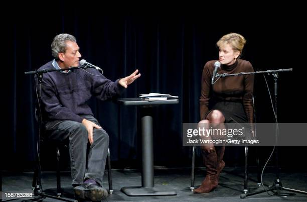 American author Paul Auster gestures as he answers as question during an interview conducted by his wife fellow author Siri Hustvedt at the Symphony...
