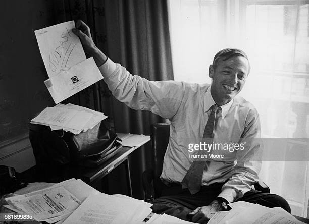 American author political critic and editor of the 'National Review' William F Buckley laughs as he holds up a piece of hate mail New York New York...