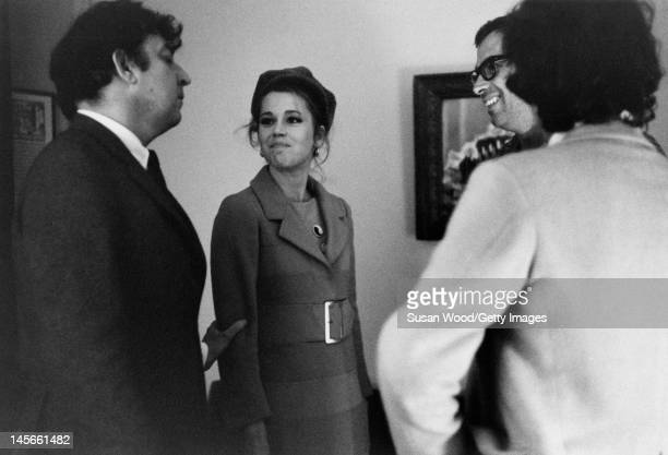 American author screenwriter Terry Southern clowns around with actress Jane Fonda her husband French film director Roger Vadim and an unidentified...