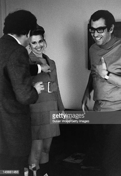 American author screenwriter Terry Southern clowns around with actress Jane Fonda and her husband French film director Roger Vadim left during a...