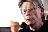 American author Stephen King poses for photographers on November 13 2013 in Paris before a book signing event dedicated to the release of his new...
