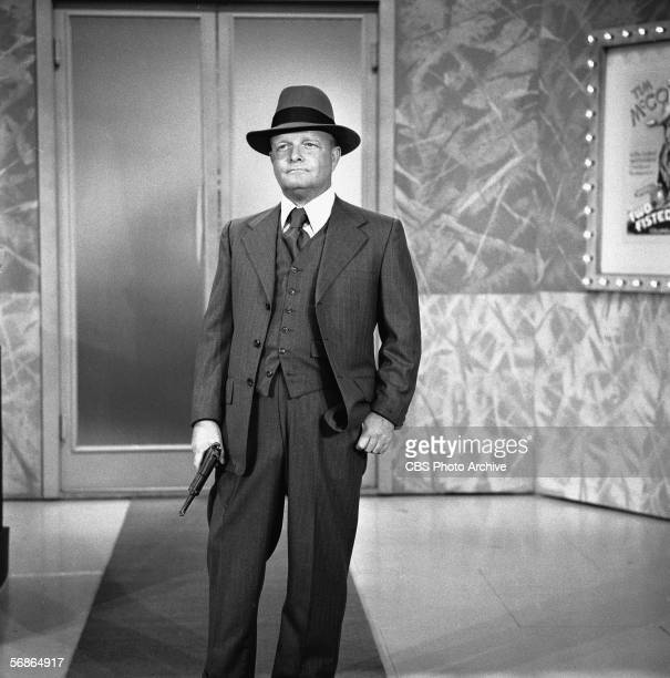 American author Truman Capote wears a threepiece suit and fedora and carries a gun presumably in role as a 1930s gangster in a skit on the 'Sonny and...