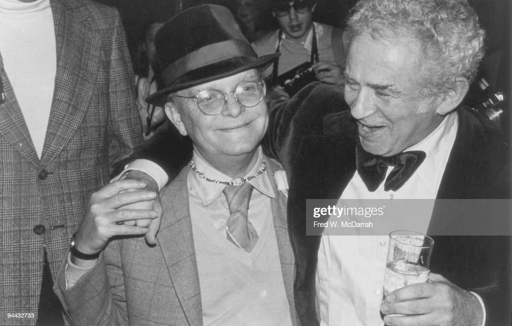 American authors Truman Capote (born Truman Streckfus Persons, 1924 -1984) (left) and Norman Mailer (1923 - 2007) share a laugh at a party, New York, New York, March 21, 1978. The party was held in honor of the publication of Dotson Rader's book 'Miracle.'