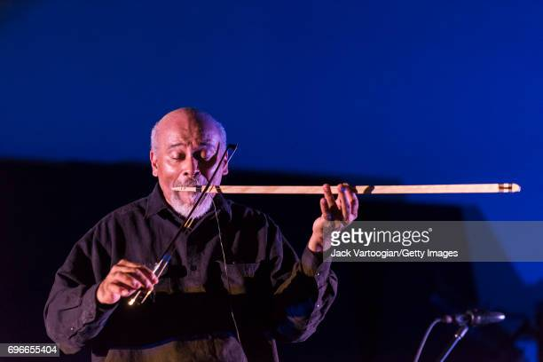 American AvantGarde Free Jazz musican CooperMoore plays a handmade electric mouth bow as he leads his band Digital Primitives during 'Vision Festival...