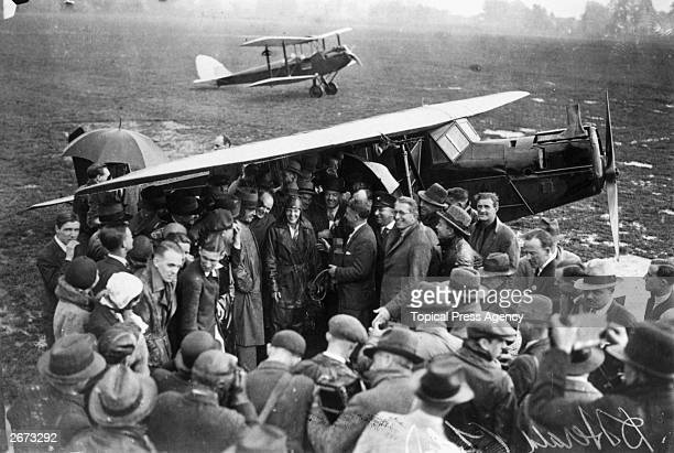 American aviator Amelia Earhart is surrounded by a crowd of wellwishers and pressmen on arrival at Hanworth airfield after crossing the Atlantic She...