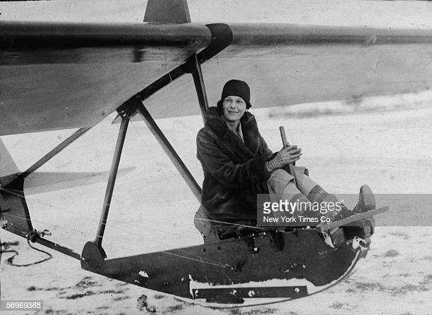 American aviator Amelia Earhart sits at the controls of an experimental glider before a flight at the Scripps estate 'Wildwood Farms' Lake Orion...