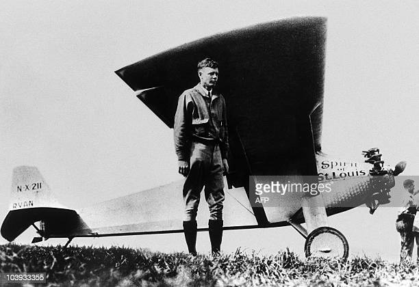 American aviator Charles Lindbergh poses in front of his monoplane Spirit of StLouis at ParisLe Bourget 21 May 1927 after having achieved the first...