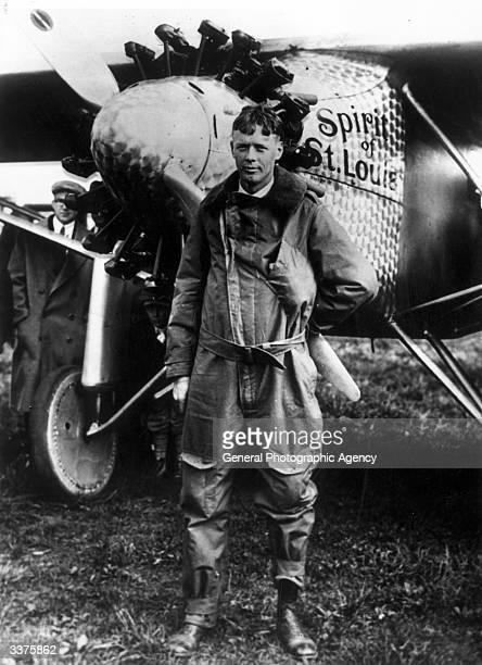 American aviator engineer and Pulitzer Prize winner Charles Lindbergh poses with the 'Spirit of St Louis' the plane he used to make the first nonstop...