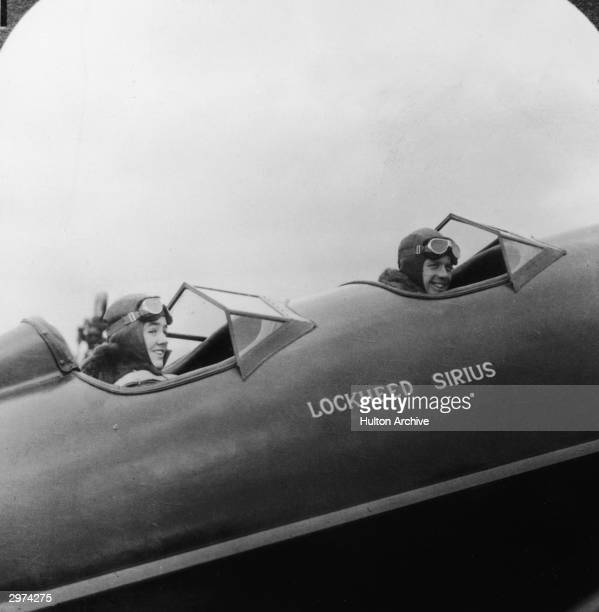 American aviators Charles A Lindbergh and his wife and navigator Annie Morrow Lindbergh in a Lockheed Sirus monoplane during their flight from the...