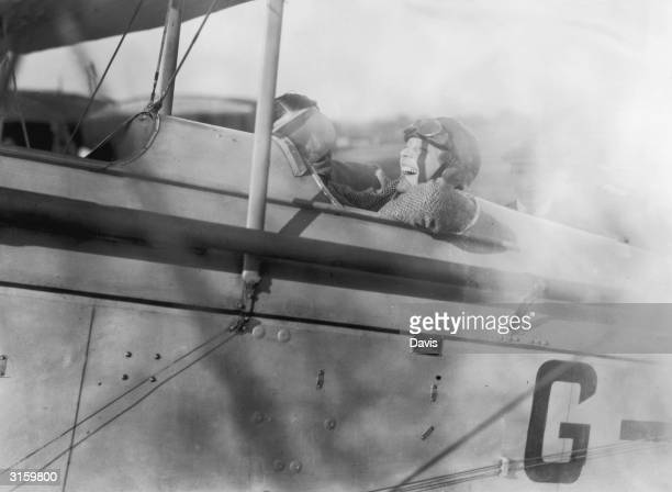 American aviatrix Amelia Earhart laughs with joy during a trip to Northolt in a Moth plane 24th June 1928