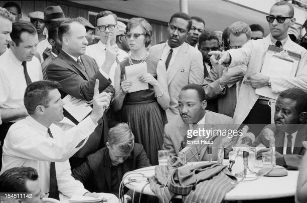 American Baptist minister and civil rights leader Martin Luther King Jr gives a press conference regarding an agreement reached on a 'limited...