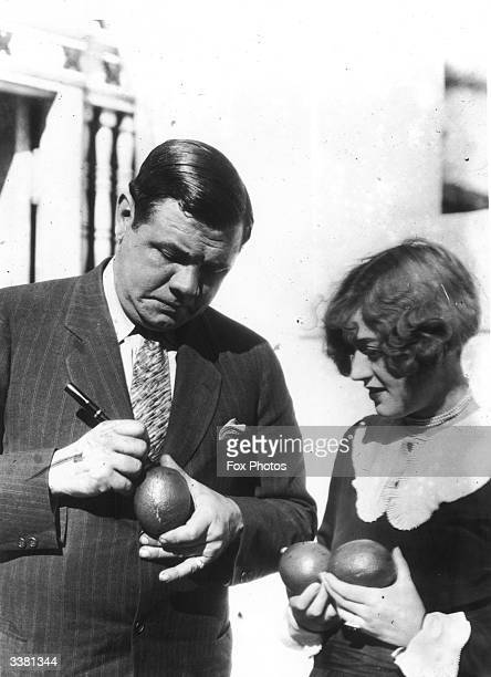 American baseball legend Babe Ruth signing a woman's avocado pear