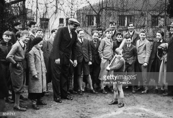 American baseball player Babe Ruth conducts a baseball class with the boys of McJannet and Chateau de Bures schools near Paris France
