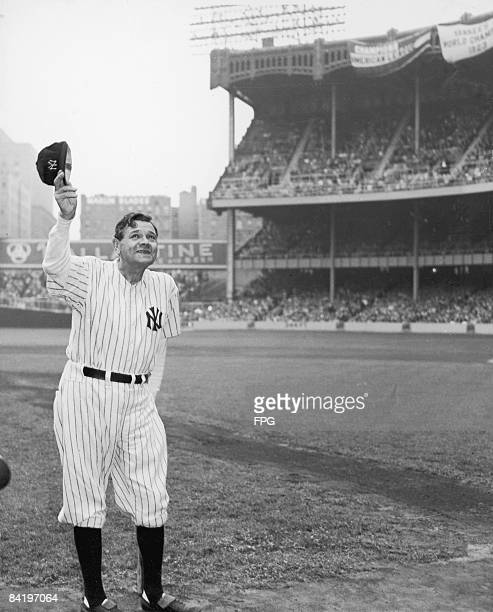 American baseball player Babe Ruth dressed in his old New York Yankees number waves to the crowd during a reunion of Yankee AllStars at Yankee...