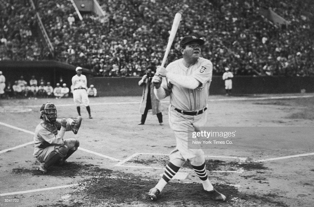 American baseball player <a gi-track='captionPersonalityLinkClicked' href=/galleries/search?phrase=Babe+Ruth&family=editorial&specificpeople=94423 ng-click='$event.stopPropagation()'>Babe Ruth</a> (George Herman Ruth, 1895 - 1948) hits his first home run during his tour of Japan at Miji Shrine Stadium, Tokyo, Japan.