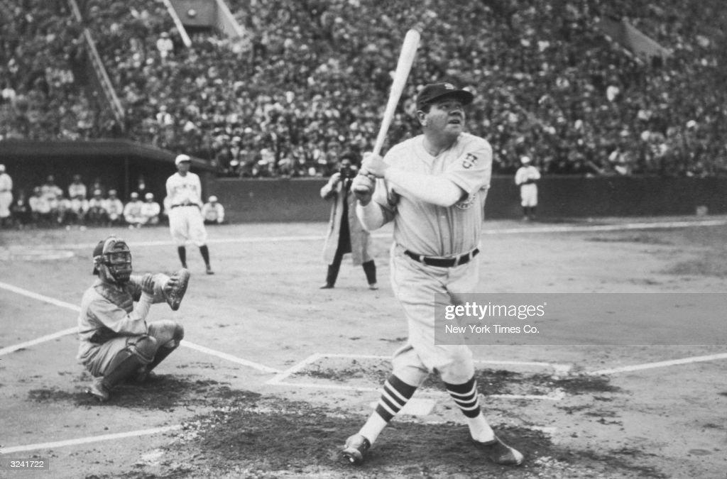American baseball player Babe Ruth hits his first home run during his tour of Japan at Miji Shrine Stadium Tokyo Japan