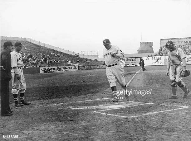 American baseball player Babe Ruth of the Boston Braves crosses home plate as he scores his team's only point in an 81 loss to the Brooklyn Dodgers...