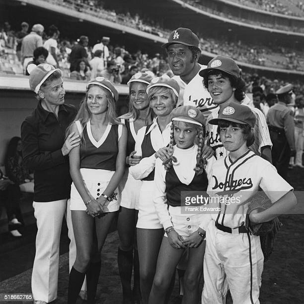 American baseball player Don Newcombe with the cast of the US TV sitcom 'The Brady Bunch' at a charity baseball game at Dodger Stadium Los Angeles...
