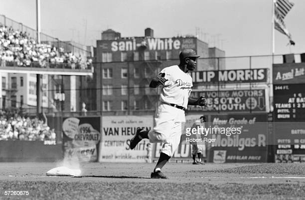 American baseball player Jackie Robinson of the Brooklyn Dodgers rounds third base during a home game at Ebbets Field New York New York 1950s