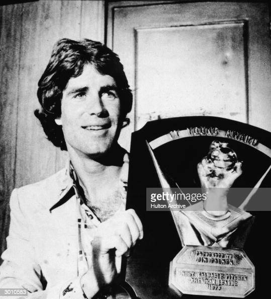 American baseball player Jim Palmer holds up his Cy Young award one of three he won over the course of his career 1975
