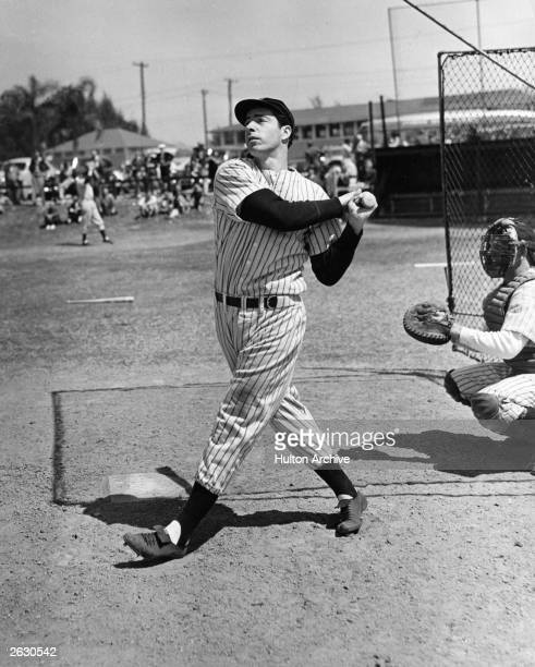 American baseball player Joe DiMaggio hits a belter circa 1948