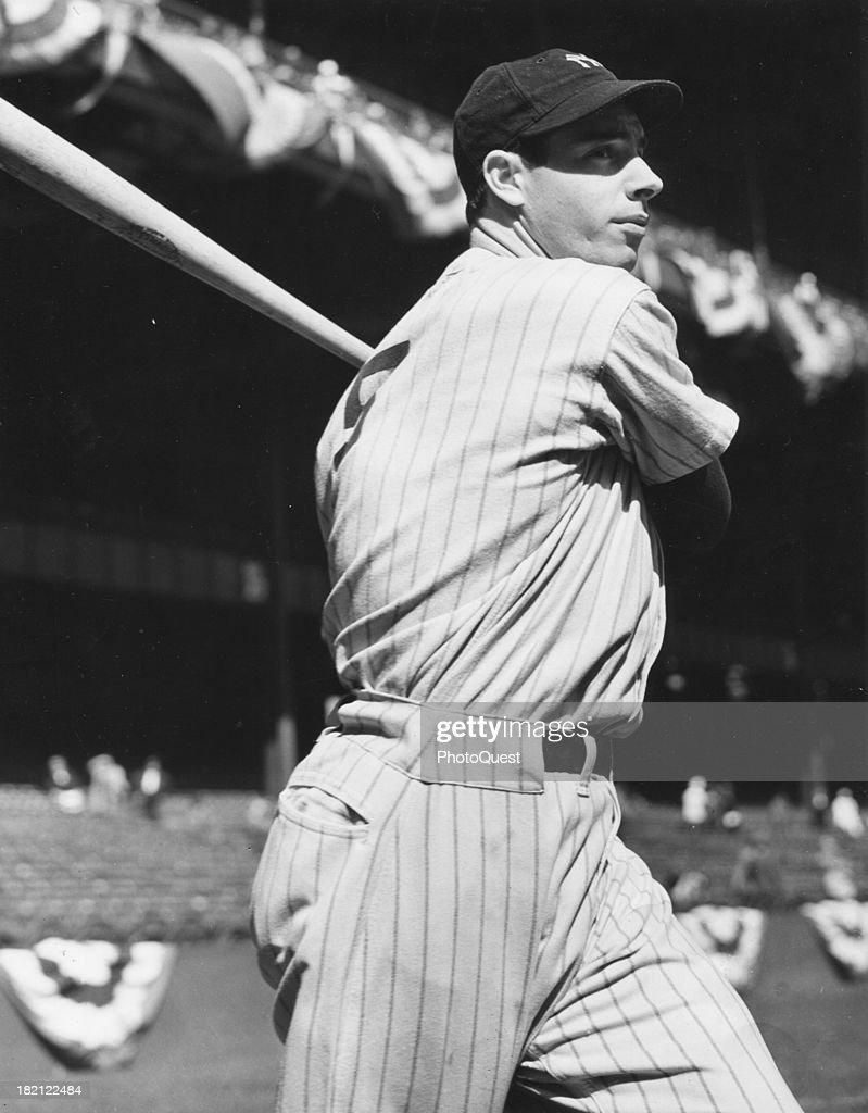 American baseball player Joe Dimaggio (1914 - 1999) of the New York Yankees swings a bat, mid 20th century.