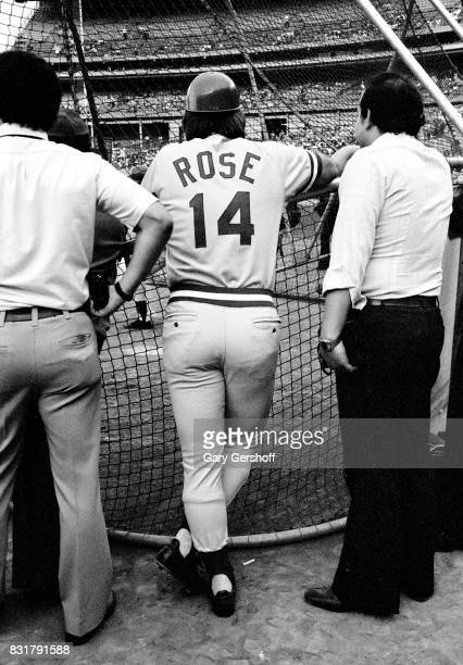 American baseball player Pete Rose of the Cincinatti Reds watches batting practice on the field before a game at Shea Stadium in Flushing...