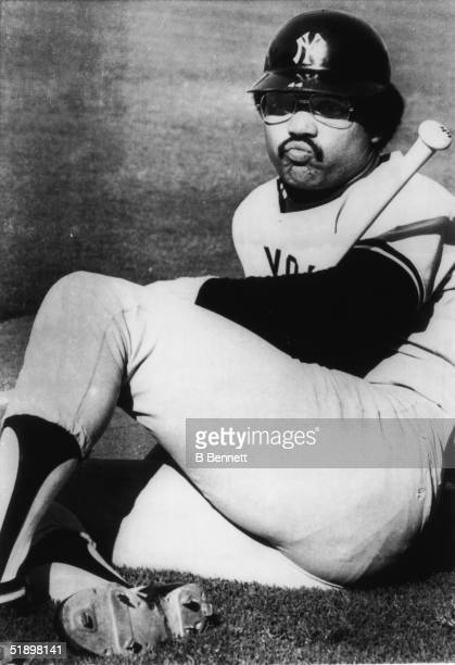 American baseball player Reggie Jackson outfielder for the New York Yankees relaxes on the field and watches his teammates workout prior to a World...