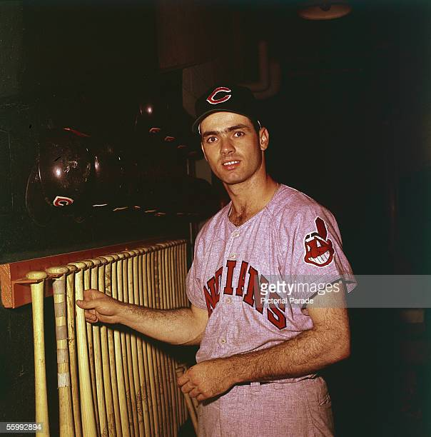 American baseball player Rocky Colavito of the Cleveland Indians poses for a portrait as he reaches for a bat on a rack 1958 or 1959 Season