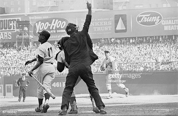 American baseball player Sandy Koufax pitcher for the Los Angeles Dodgers watches as the umpire calls a strike out on New York Yankee Hector Lopez in...