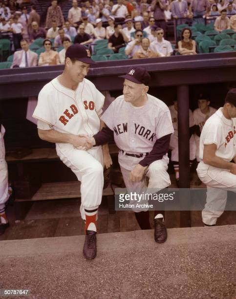 American baseball player Ted Williams of the Boston Red Sox shakes hands with Casey Stengel the manager of the New York Yankees circa 1950s