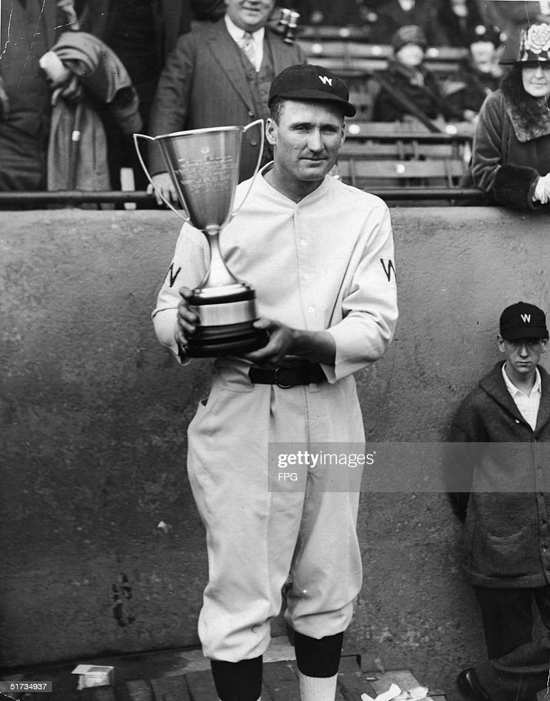 American baseball player Walter Johnson pitcher for the Washington Sentors poses with a trophy he has just been awarded 1920s