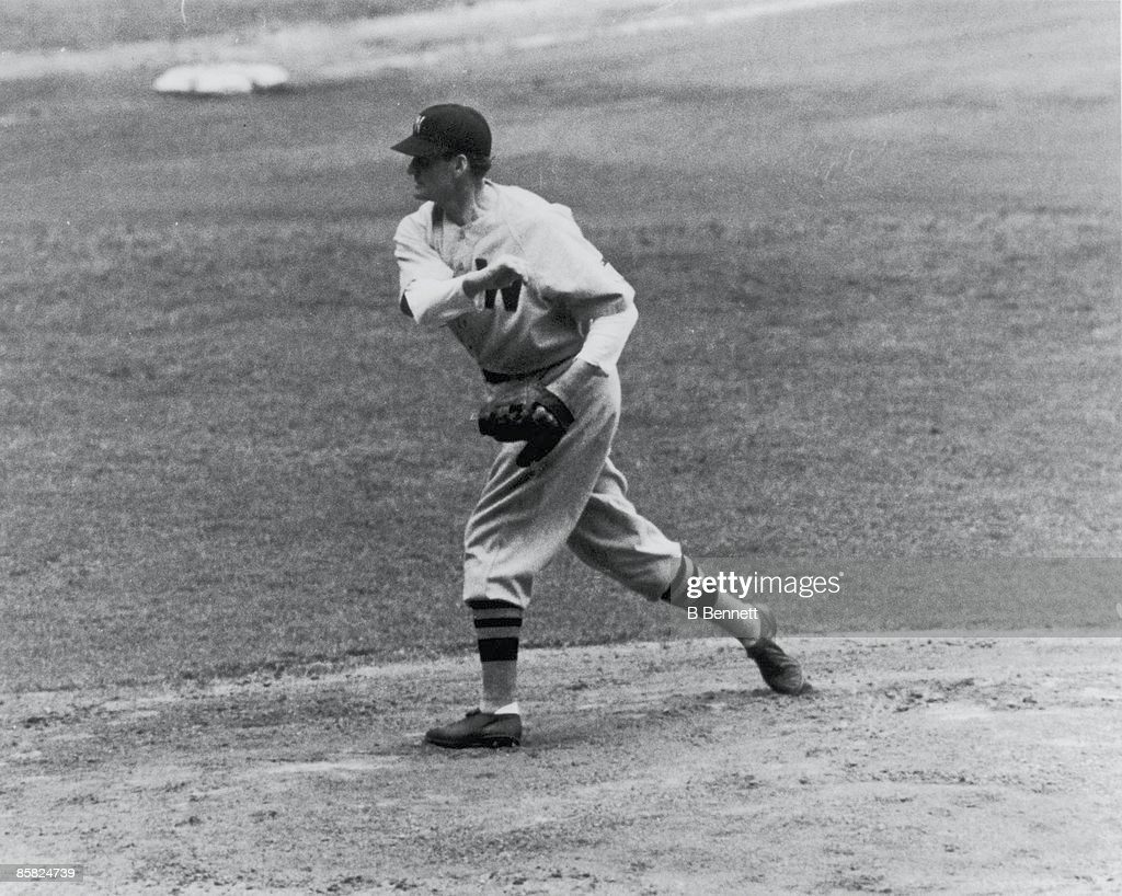 American baseball player Walter Johnson pitcher for the Washington Senators throws from the mound during a game 1942